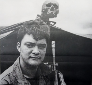 An American soldier with the skull of a Vietnamese patriot.