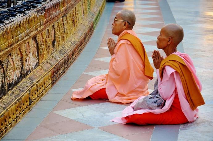 Lady monks praying