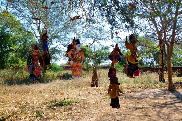 Puppets hanging from a tree