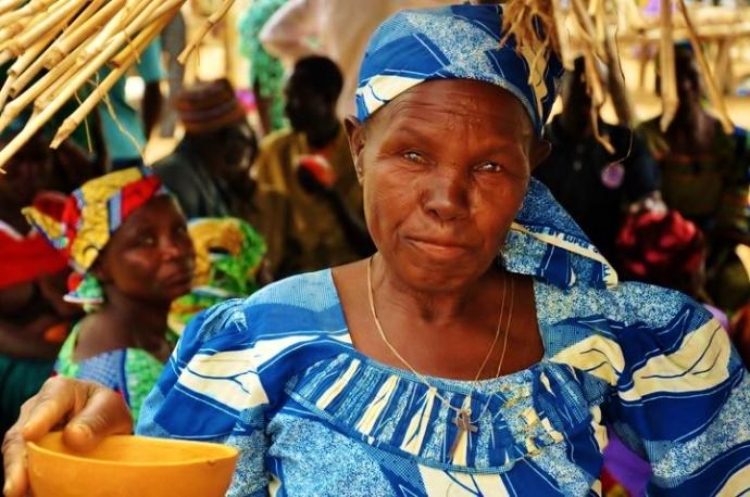 Woman drinking bil bil (fermented millet)